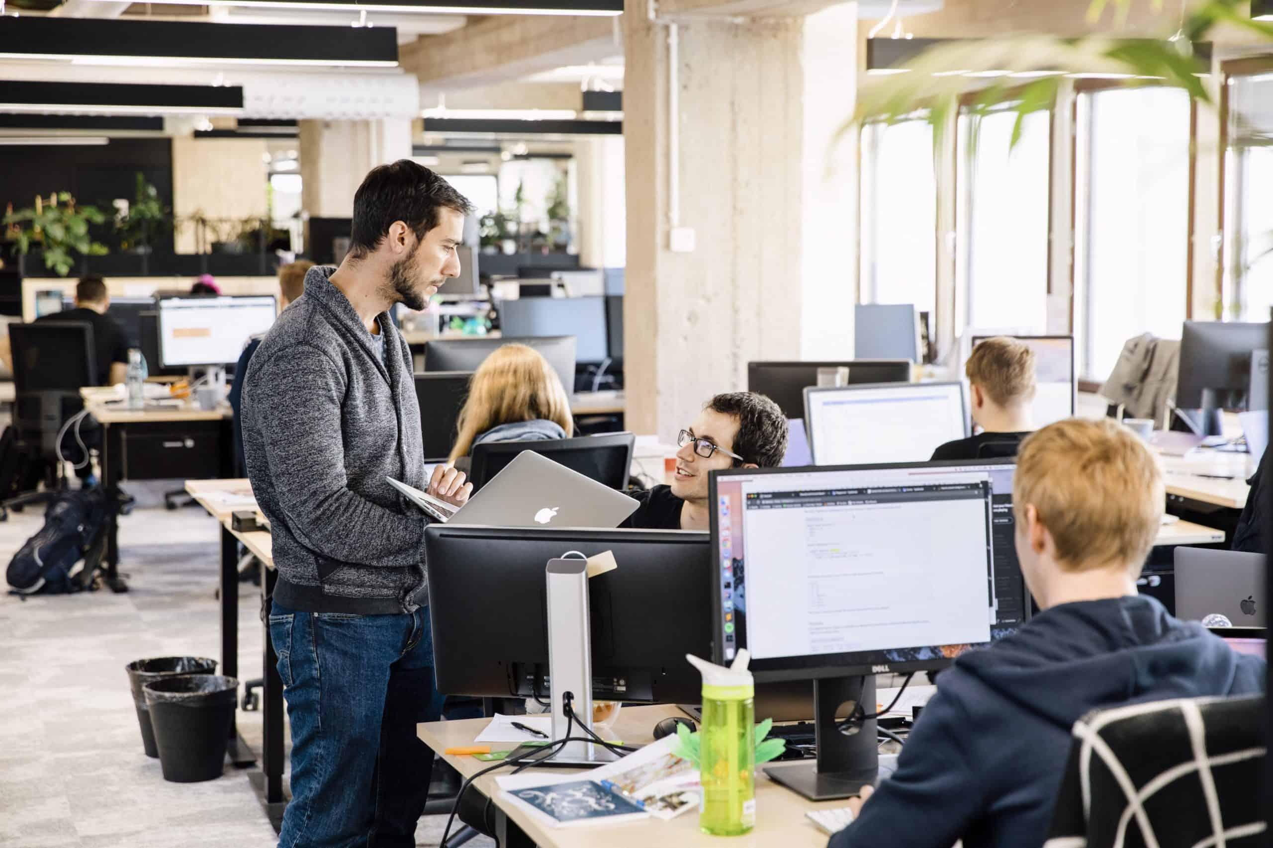 People in an open plan office.